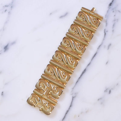 Vintage Kenneth Jay Lane Wide Panel Gold Scroll Bracelet by Kenneth Jay Lane - Vintage Meet Modern Vintage Jewelry - Chicago, Illinois - #oldhollywoodglamour #vintagemeetmodern #designervintage #jewelrybox #antiquejewelry #vintagejewelry