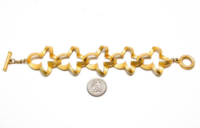 Gold Tone Quatrefoil Link Bracelet by Givenchy by Givenchy - Vintage Meet Modern - Chicago, Illinois