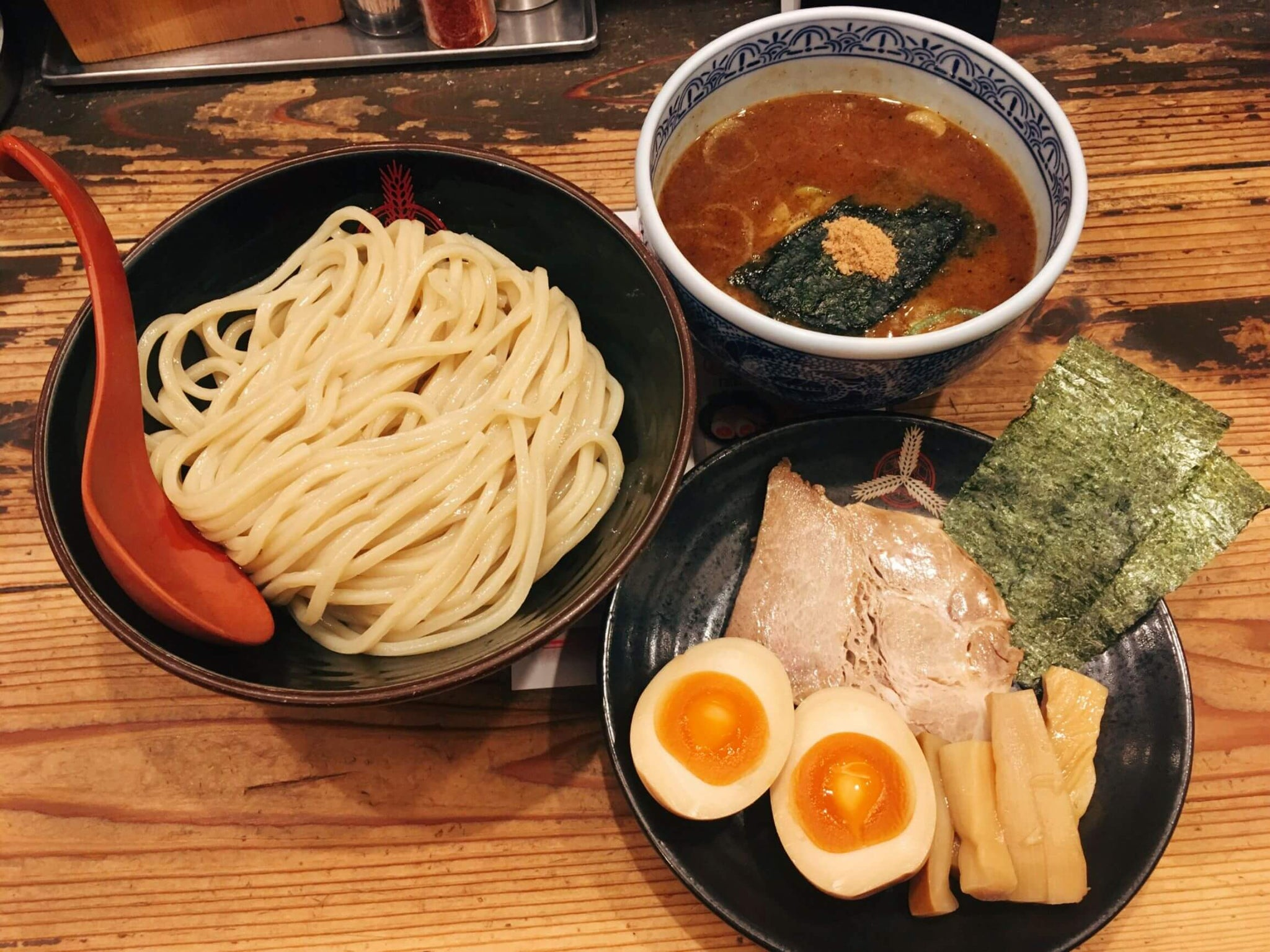 tsukemen, the noodles, broth and toppings are served in three different bowls.
