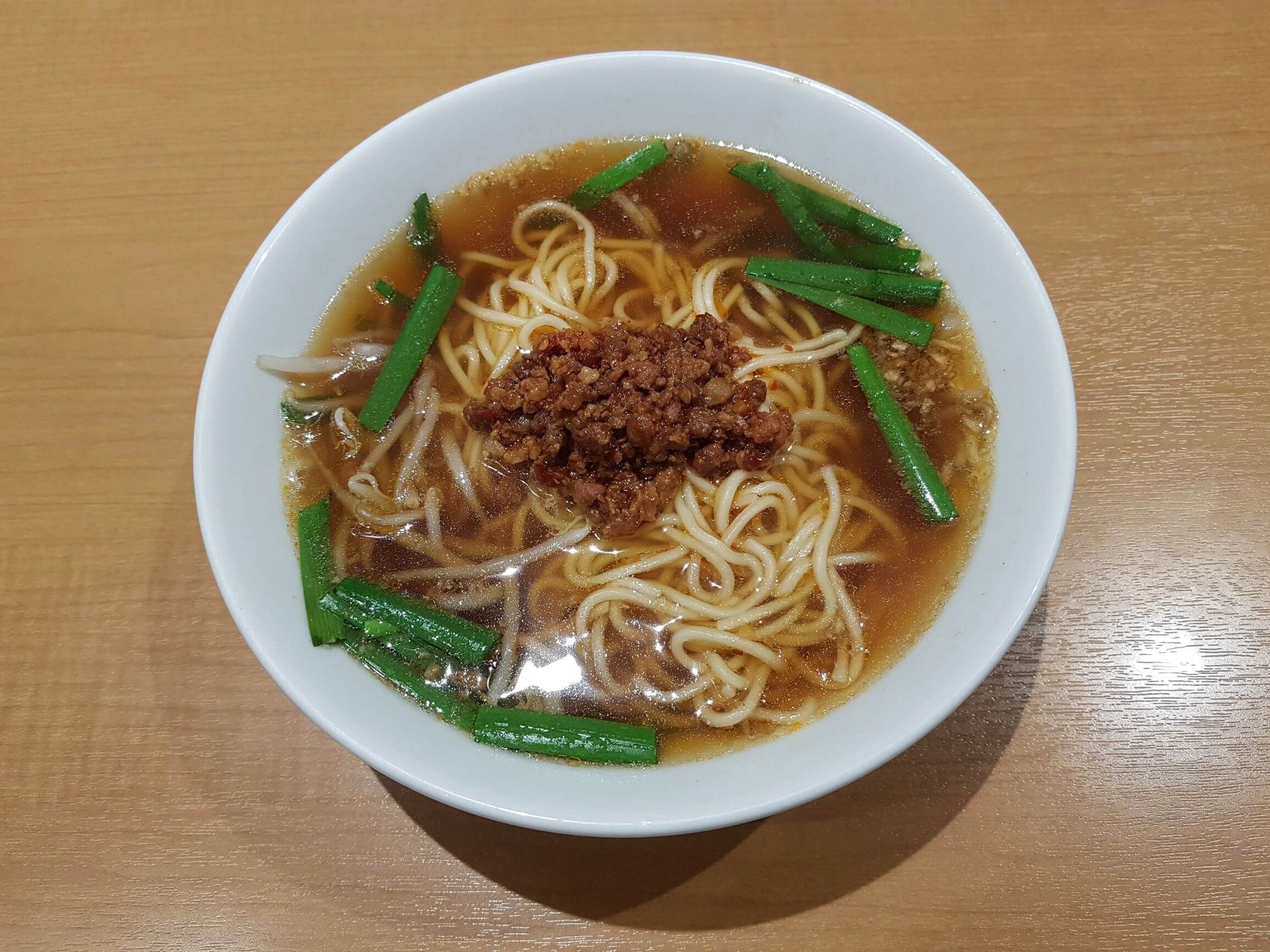 taiwan ramen served with spicy ground pork and garlic chives