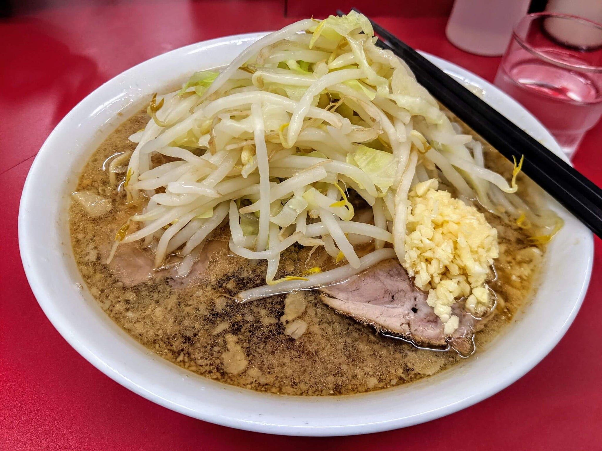 Jiro ramen, pork broth ramen topped with bean sprout, cabbage, roasted pork and minced garlic