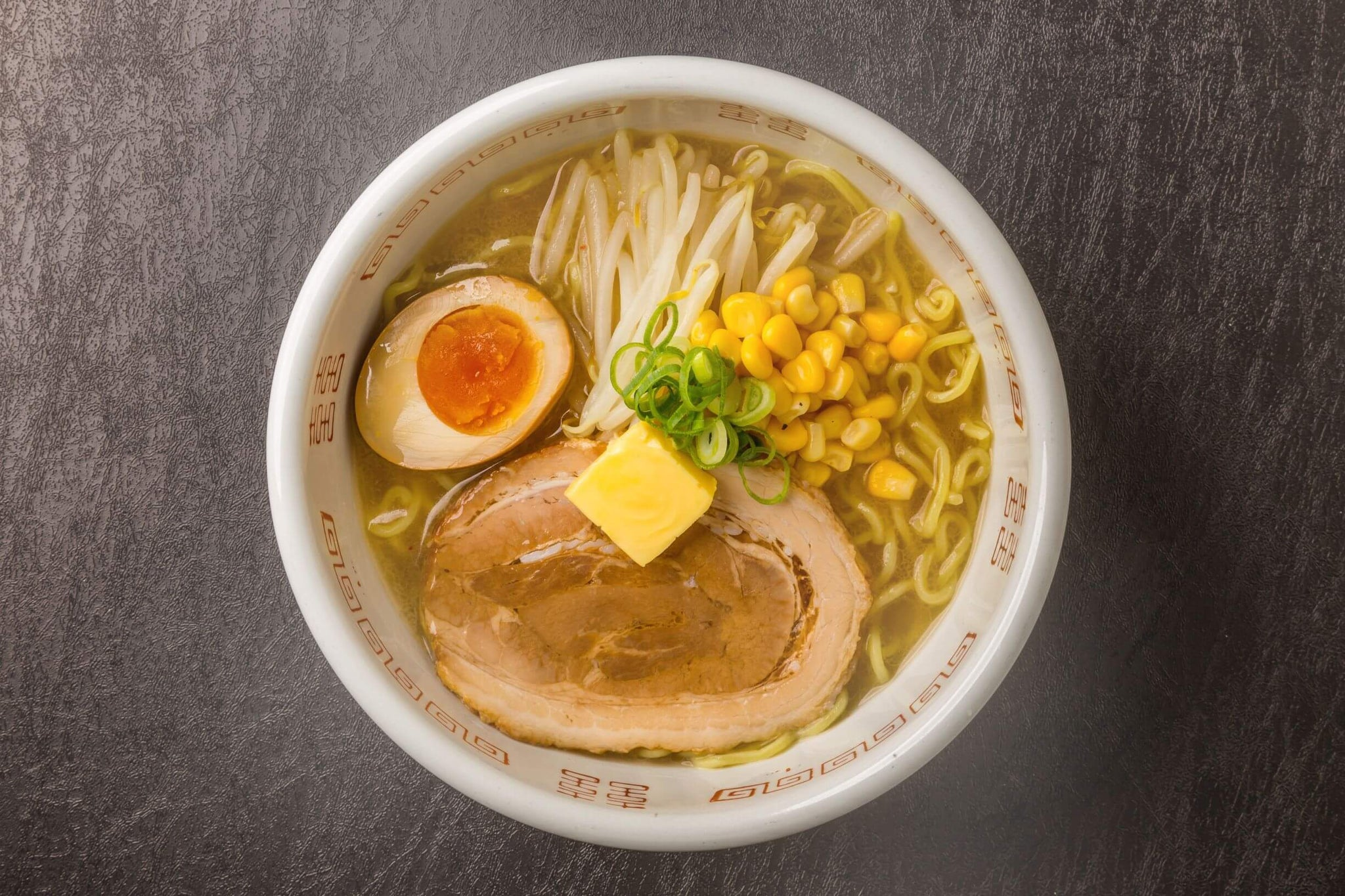 Miso ramen served with hot miso broth, sweet corn, boiled egg, roasted pork and a slice of butter.