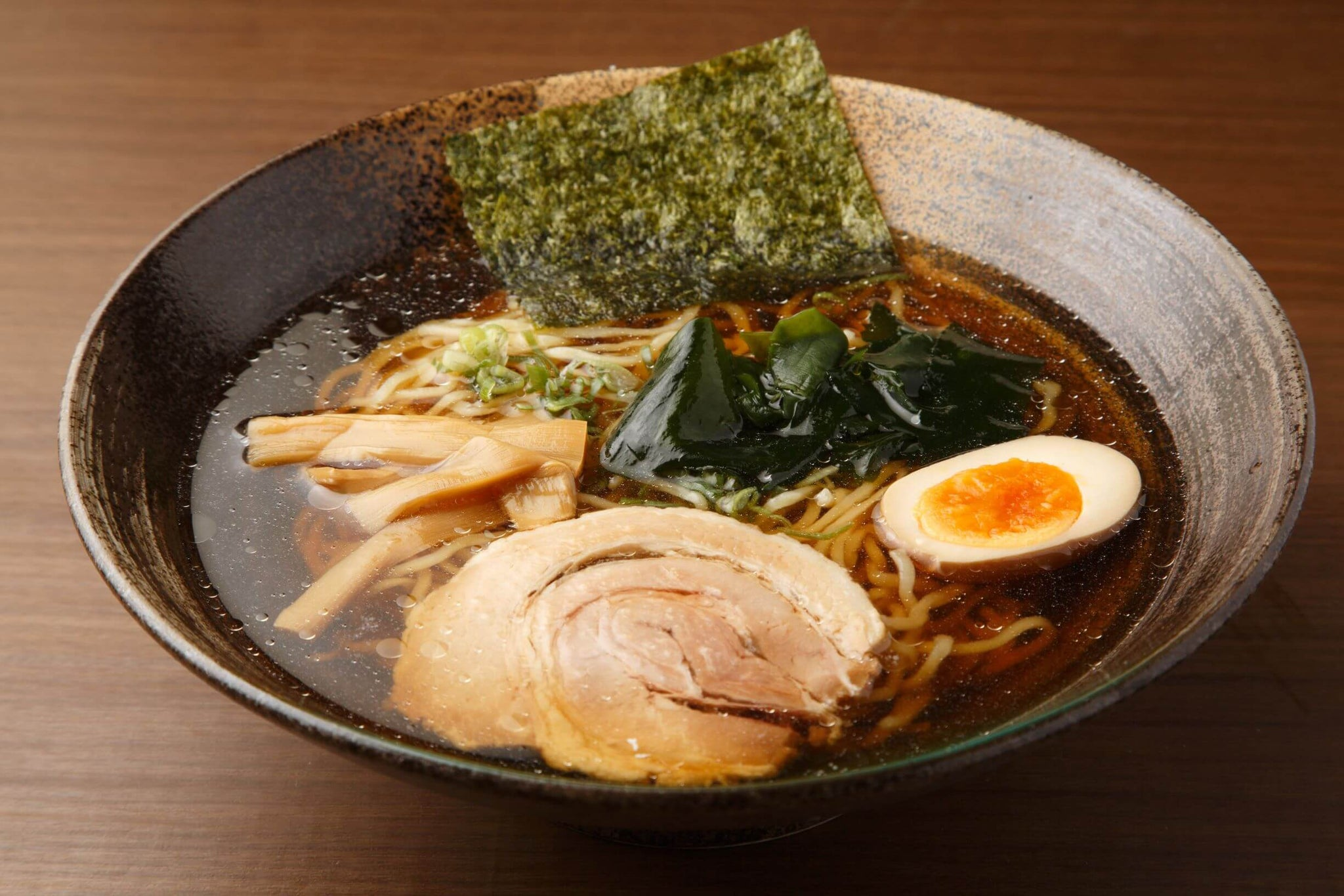 Tokyo ramen, a type of shoyu ramen topped with a boiled egg, seaweed, roasted pork and bamboo