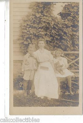 RPPC-Woman with Boy and Girl-Girl Holding Teddy Bear and Boy with Gun #2 - Cakcollectibles