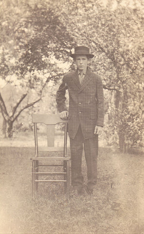 RPPC - Young Man Standing By A Chair