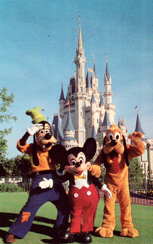 Mickey Mouse,Goofy and Pluto by Cinderella Castle.Vintage postcard front