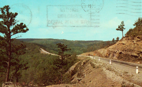 Vintage postcard front.Scenic Highway 7 in The Arkansas Ozarks