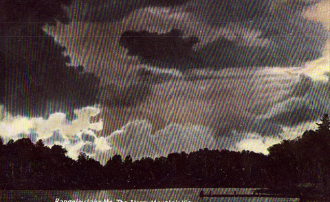 Vintage postcard front.The Storm Mountain View - Rangeley Lake,Maine
