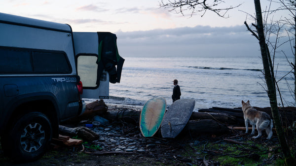 Campervan with surfboards at the beach for ecologyst Canadian surf film Blue Hour