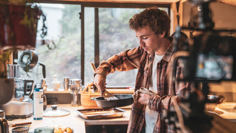 Alt-Text: Luke-Wallace-Cooking-In-Cabin-Organic-Food