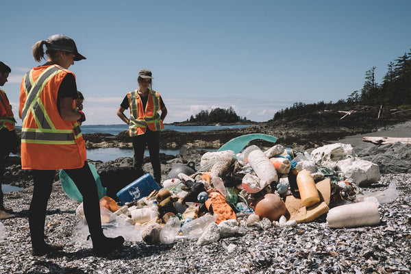 ecologyst collecting plastic on canadian beach with clayoquot clean up for film plastic beach