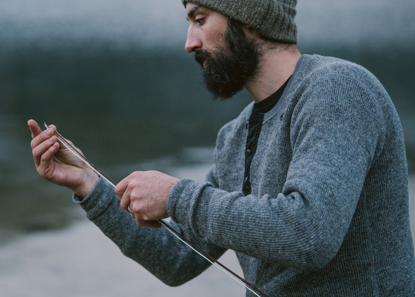 Stanfield's x ecologyst Henley in Grey worn by Teddy fishing on lake in British Columbia Canada