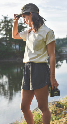 Woman wearing grey Tencel Shorts with Camp Cap