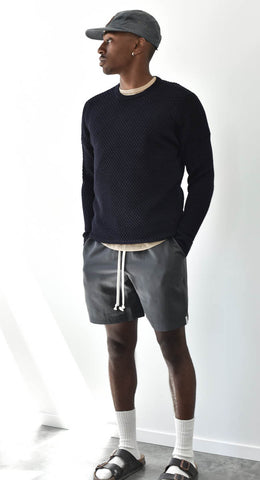 Man wearing grey Tencel Shorts with navy Merino Sweater