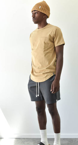 Man wearing grey Tencel Shorts and Yellow Work Tee with Toque