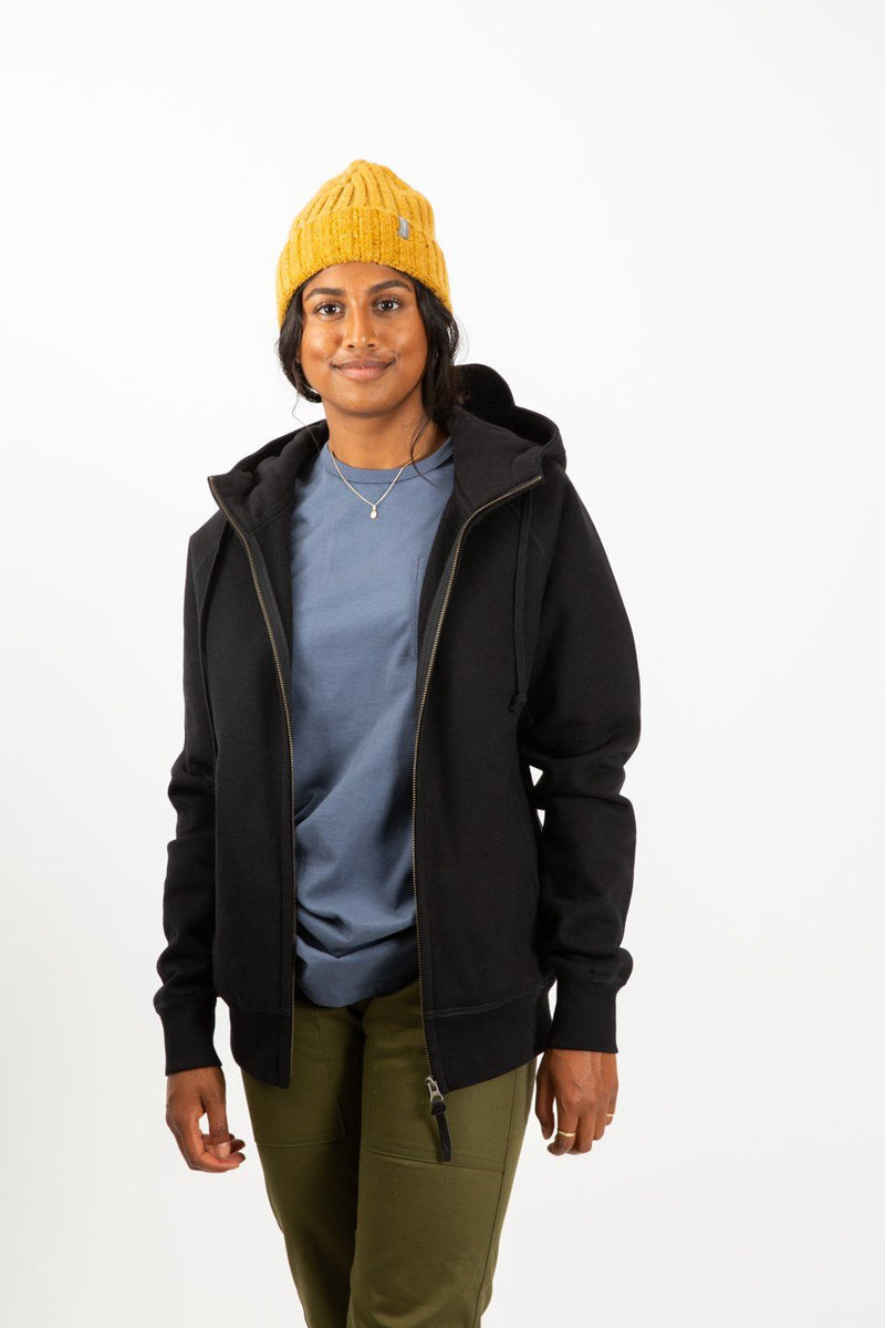 The Sitka Peak Hoodie Black on a woman