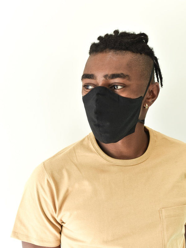 Man in black cotton/linen face mask front view