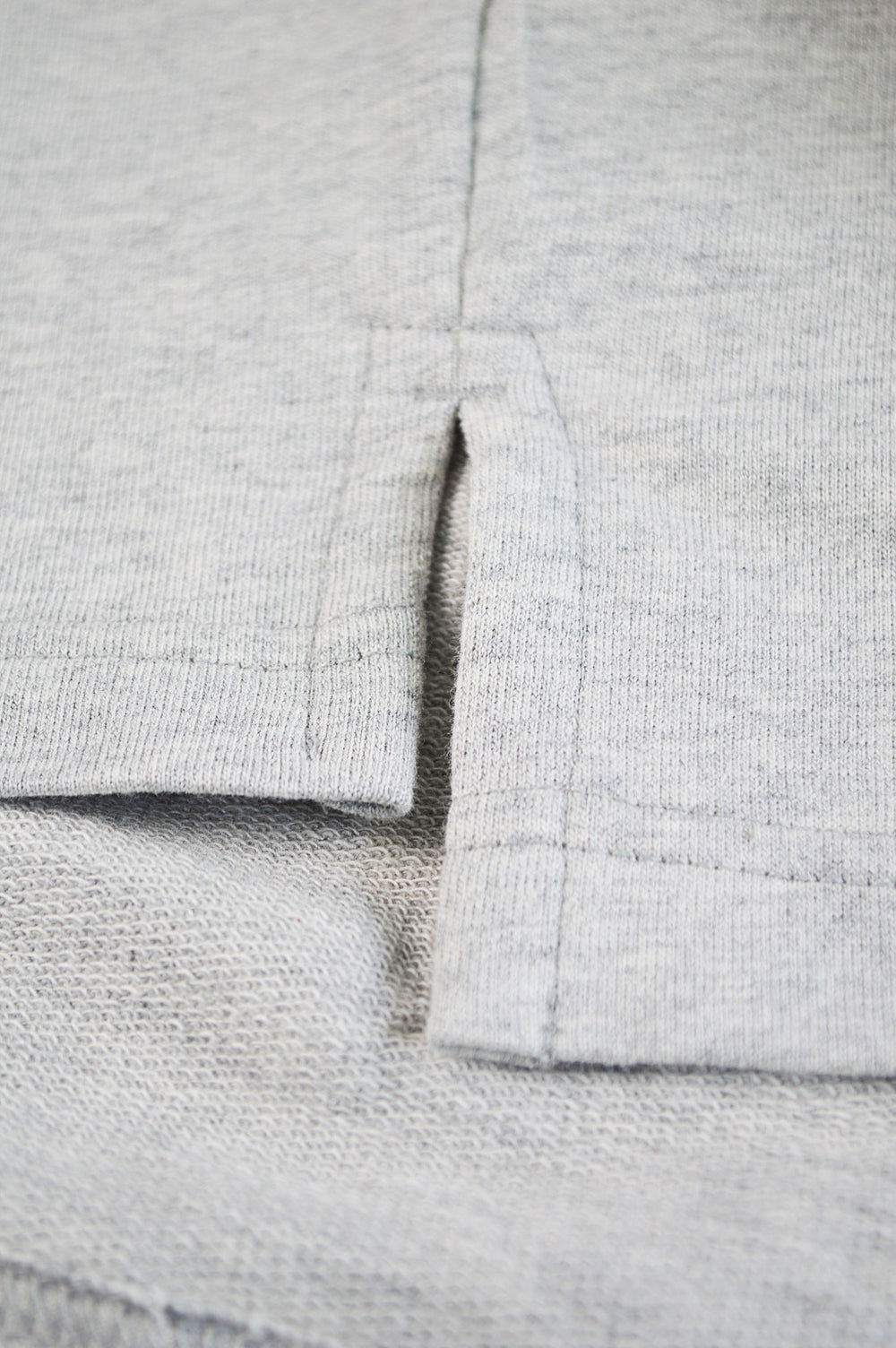 Close up side split in henley shirt