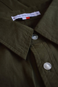 Close up front placket buttons and tag