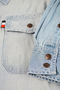 Close up pocket with tag and buttons on cuff
