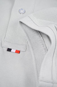 bottom of placket grey polo