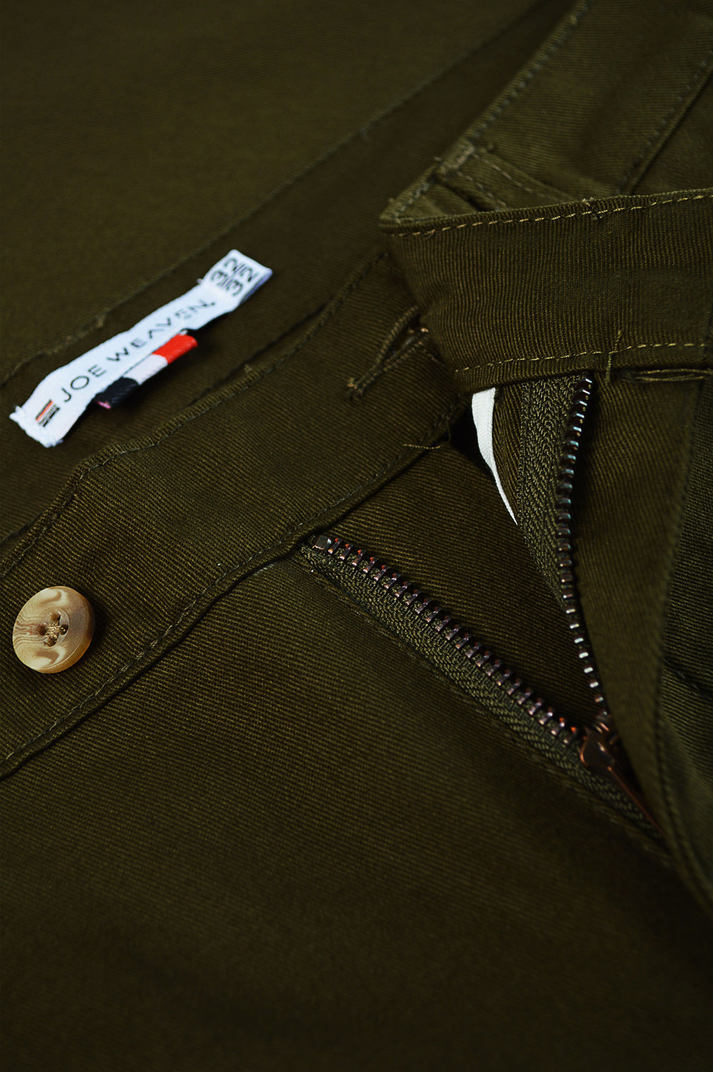 Close up front zipper and button