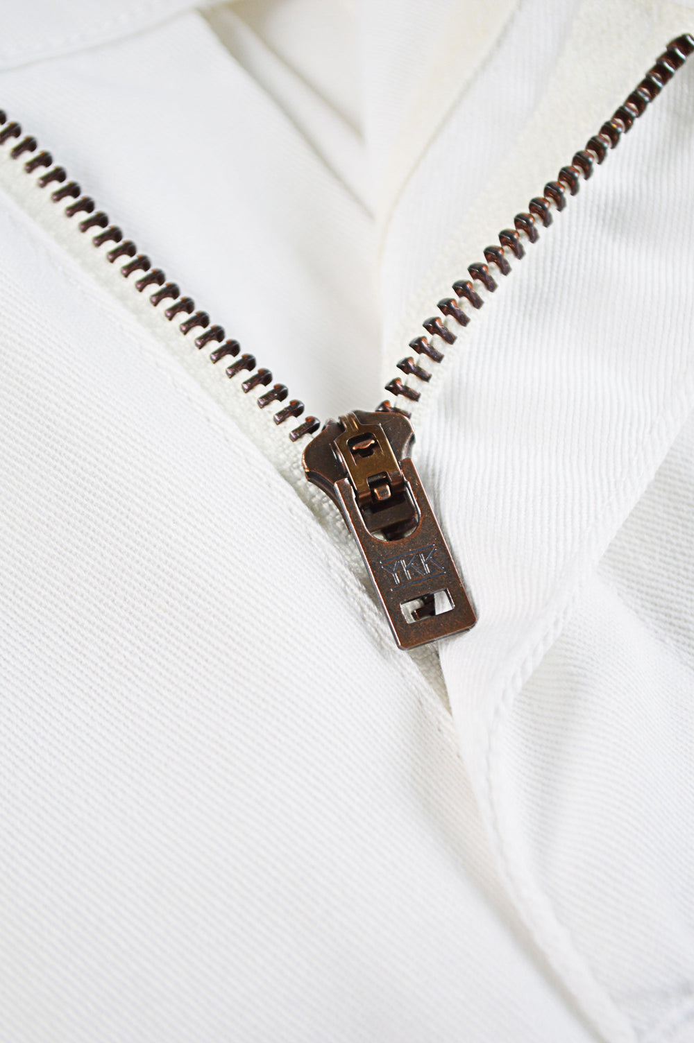 raw vintage ykk zipper on white chinos