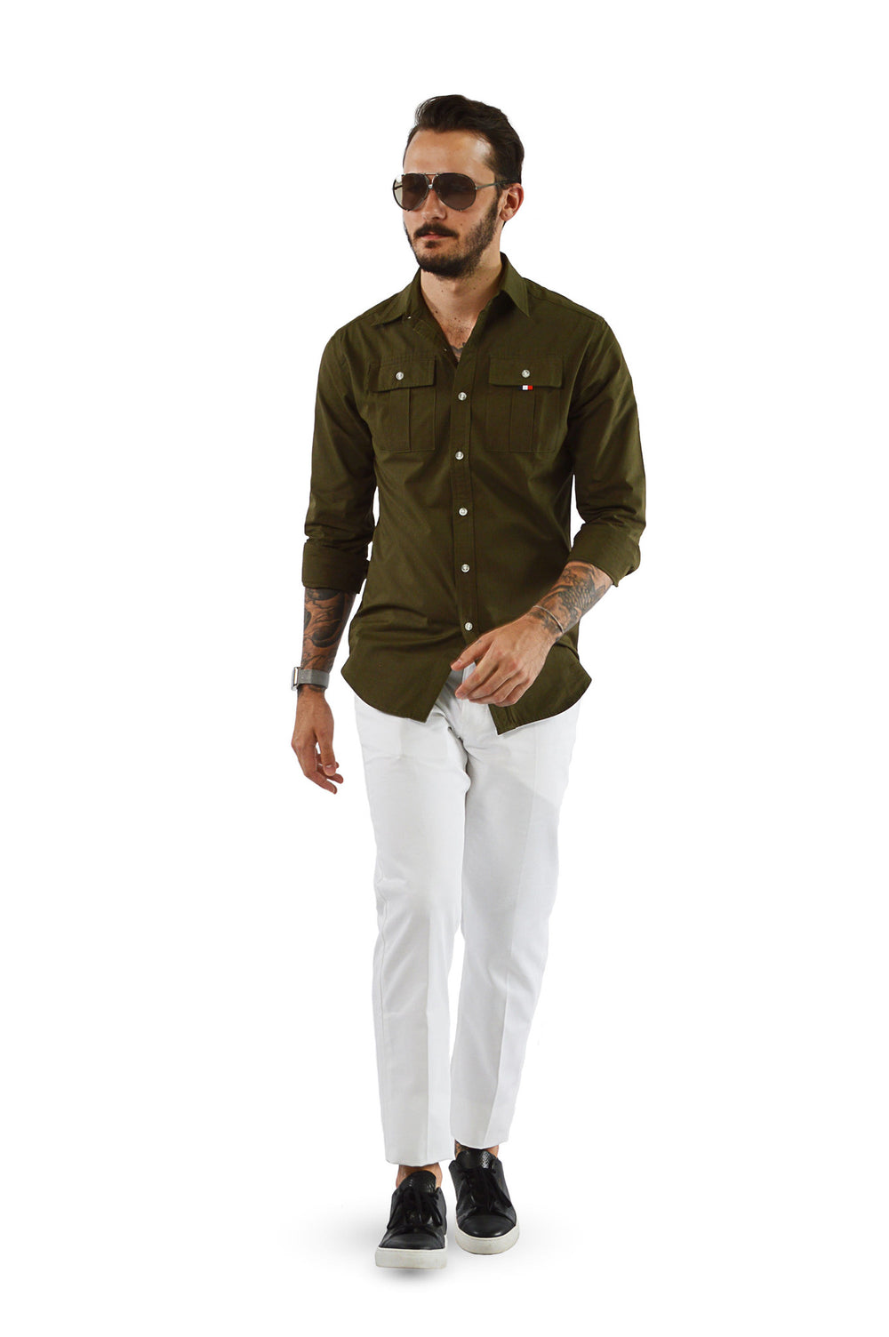 walking wearing military shirt with white chinos