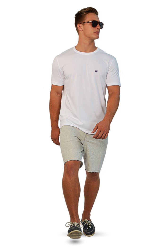 walking wearing white t-shirt with gym shorts
