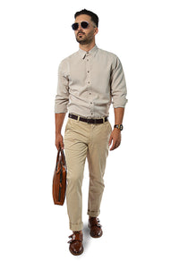 walking wearing non-iron linen shirt and camel chinos