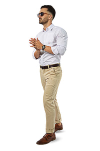 walking wearing white shirt with camel chinos