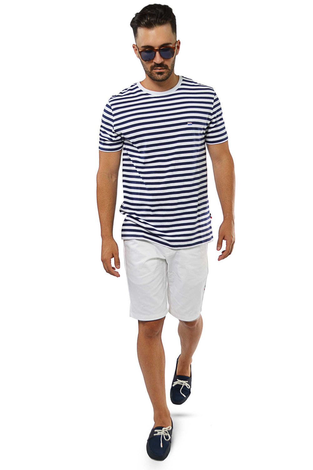 walking wearing navy stripe t-shirt with white shorts