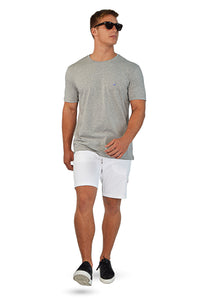 walking wearing grey t-shirt and white tailored shorts