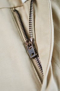 Close up raw bronze YKK zipper