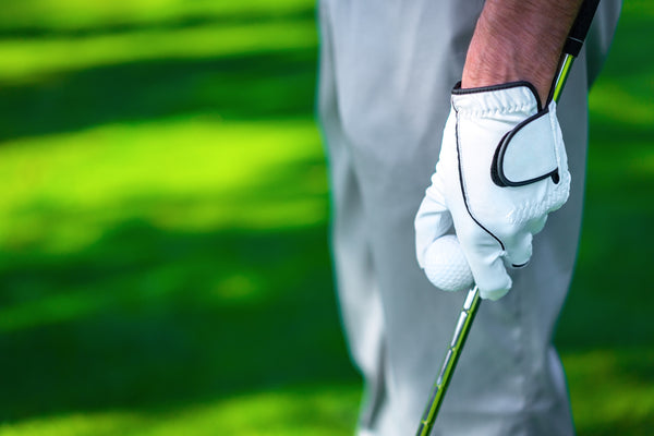 Golfer with glove and ball