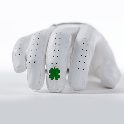 Fingers closeup of white Lucky Elite Bender Glove. All white design with green lucky clover