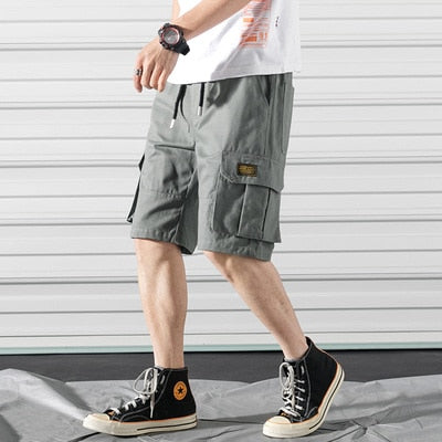 New Men's shorts Fashion Summer Tooling shorts Cotton Casual Mens Multi-pocket knee length Solid color Shorts plus size 5XL