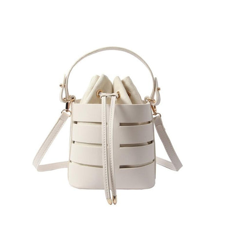 Solid Color Rivet Design New Fashion Small Fairy Bag Women Portable Bucket Bag Hollow PU Female Shoulder Messenger Bag