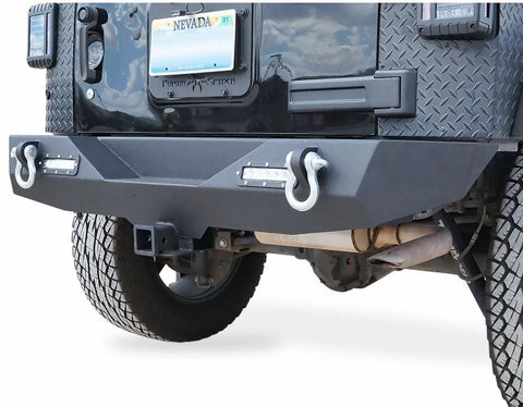 Heavy duty rear bumper designed for the JK series Wranglers.  Multi-angled, 3D transformer design with two D-ring hooks, standard hitch hole and dual LED backup lamps.