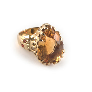 Fire Ring with a 20 x 15 golden citrine gemstone set in 18 carat gold.