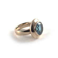 Moon Ring with a swiss blue gemstone set in 9 ct gold.