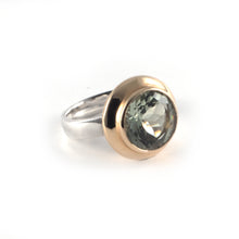 Moon Ring with a green amethyst gemstone set in 9 ct gold and sterling silver.