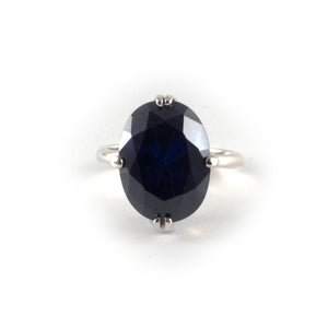 Oval Float Ring with a 16 x 12 tanzanite blue topaz crystal set in sterling silver.