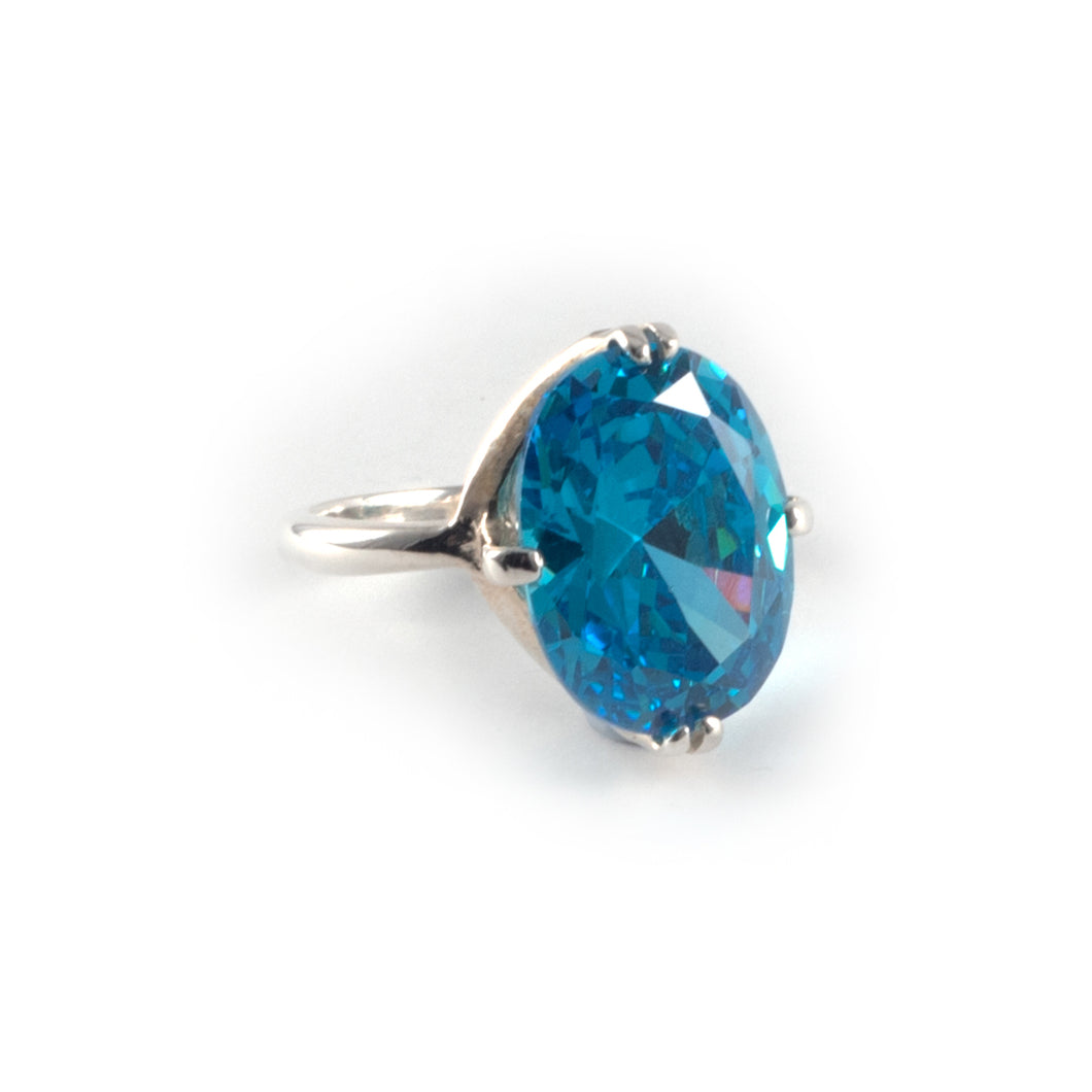 Oval Float Ring with a 16 x 12 paraiba blue topaz crystal set in sterling silver.