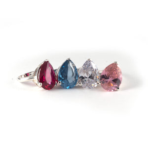 Pear Tilt Ring with a red, blue, white  and pink diamond crystal set in sterling silver.