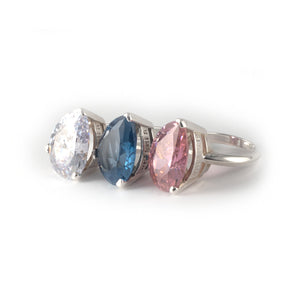 Pear Tilt Ring with a white, blue, and pink diamond crystal set in sterling silver.