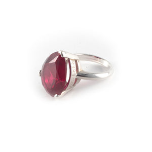 Pear Tilt Ring with a ruby crystal set in sterling silver.