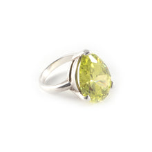 Pear Tilt Ring with a peridot crystal set in sterling silver.
