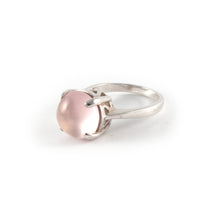 Round Crown High Ring with a rose quartz set in sterling silver.