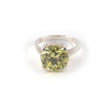 Round Crown High Ring with a peridot crystal set in sterling silver.